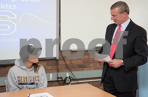05/02/18 Wesley Bunnell | Staff Southington student athlete Taylor Hubert is introduced by head girls soccer coach Mike Linehan prior to her signing her letter of intent to attend and play soccer for Div. II Merrimack College.