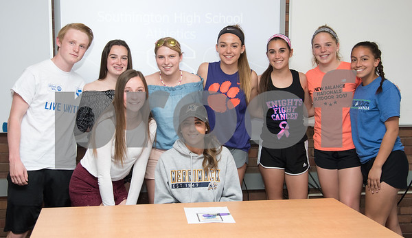 05/02/18 Wesley Bunnell | Staff Southington student athlete Taylor Hubert is surrounded by her friends and teammates after signing her letter of intent to attend and play soccer for Div. II Merrimack College.