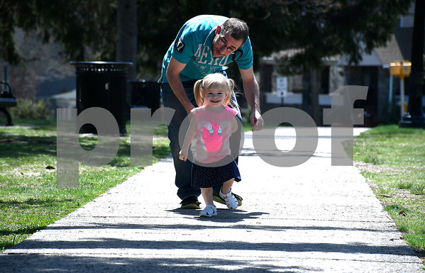 5/2/2018 Mike Orazzi | Staff Jerry Lestoric and his daughter Abigail,2, while out on a nice day on the Federal Hill Green in Bristol on Wednesday.