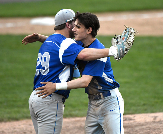 5/2/2018 Mike Orazzi | Staff Bristol Eastern's Josh Nohilly (29) and Carson Sassu (1) during Wednesday's baseball game with Bristol Central at Muzzy Field.