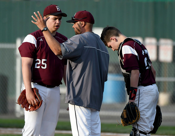 5/2/2018 Mike Orazzi | Staff Bristol Central's Stephen Warkoski (25) and baseball coach Bunty Ray during Wednesday's baseball game with Bristol Eastern at Muzzy Field.