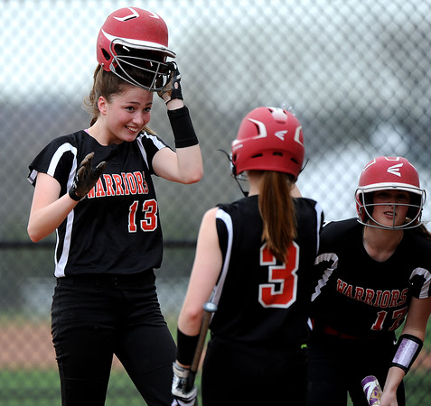 5/3/2018 Mike Orazzi | Staff Wamogo's Cassidy Wilson (13) after scoring during Thursday's softball game with in Plymouth.