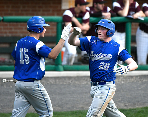 5/2/2018 Mike Orazzi | Staff Bristol Eastern's Alex DeNote (15) and Jon Pierce (28) during Wednesday's baseball game with Bristol Central at Muzzy Field.
