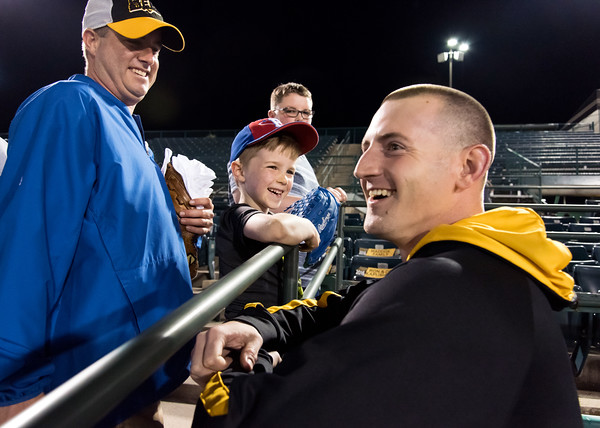 05/04/18 Wesley Bunnell | Staff The New Britain Bees held opening night at New Britain Stadium on Friday night against the Road Warriors. Bees pitcher Mike Hepple (21) smiles after handing a ball to Bryce Olinatz, age 7, after the Bees win on Friday night. Hepple, who previously played in the Mets organization, remembered Bryce and his brother Brody from the previous season as being Mets fans.