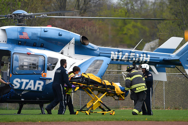 5/4/2018 Mike Orazzi | Staff Person injured during a rehab is transported by LIfe Star from Bristol Eastern High School Friday.
