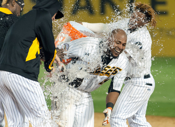 05/04/18 Wesley Bunnell | Staff The New Britain Bees held opening night at New Britain Stadium on Friday night against the Road Warriors. Deibinson Romero (24) has water dumped on him by Angelys Nina (7) after hitting a game winning hit in the bottom the 10th to give the Bees their first victory of the season.