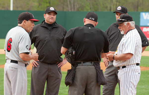 05/04/18 Wesley Bunnell | Staff Road Warriors Manager Ellie Rodriguez, L, and New Britain Bees Manager Wally Backman, R, exchange line up cards before the start of the New Britain Bees first home game of the 2018 season at New Britain Stadium on Friday night.