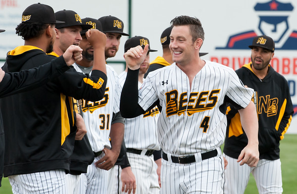 05/04/18 Wesley Bunnell | Staff Connor Bierfeldt (4) of the New Britain Bees fist bumps teammates during the team introductions on Friday night at New Britain Stadium. The New Britain Bees played their first home game of the 2018 season vs the Road Warriors.