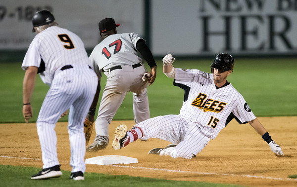 05/04/18 Wesley Bunnell | Staff The New Britain Bees held opening night at New Britain Stadium on Friday night against the Road Warriors. Reid Brignac (15) slides into third base after hitting a bases tying triple in the bottom of the ninth bringing home Jonathan Galvez (10).