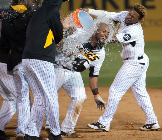 05/04/18 Wesley Bunnell | Staff Angelys Nina (7) dumps the Gatorade bucket over Deiibinson Romero (24) after Romero gave the New Britain Bees their first win on the season 9-8 over the Road Warriors with a walk off base hit in the bottom of the 10th. The New Britain Bees held opening night at New Britain Stadium on Friday night against the Road Warriors.