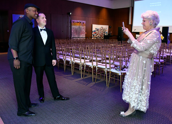 5/5/2018 Mike Orazzi | Staff Beverly Baker photographs Javier Colon and Thomas Mach during the NBMAA 18th annual spring gala and auction, The Art Party of the Year, held Saturday night in New Britain.
