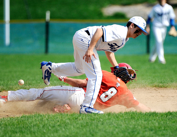 5/5/2018 Mike Orazzi | Staff St. Paul's Nick Morrell (2) as Derby's Thomas Abel (8) slides safely into second base at St. Paul Catholic High School in Bristol Saturday.