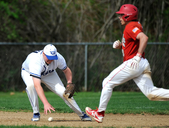 5/5/2018 Mike Orazzi | Staff St. Paul's Ryan Greene (20) as Derby's Tom Abel (8) advances to third base at St. Paul Catholic High School in Bristol Saturday.