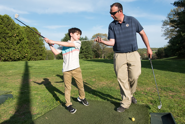 05/09/18 Wesley Bunnell | Staff Timberlin Head Golf Professional Marc S. Bayram, PGA, instructs 9 year old Raffi Blocher during his lesson on Wednesday afternoon.