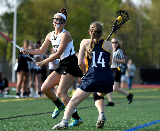 5/8/2018 Mike Orazzi | Staff Bristol Co-Op lacrosse's Gabby Abramczyk (8) and RHAM's Maggie Veronesi (14) during girls lacrosse at BEHS Tuesday.