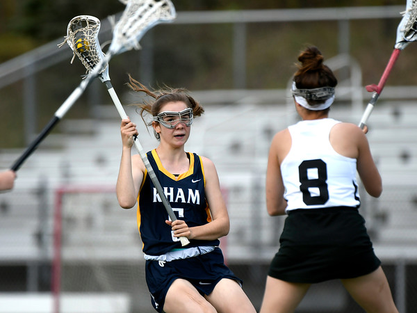 5/8/2018 Mike Orazzi | Staff RHAM's Amanda Jacobson (5) and Bristol Co-Op Lacrosse's Gabby Abramczyk (8) during girls lacrosse at BEHS Tuesday.