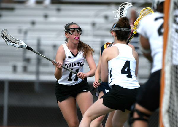 5/8/2018 Mike Orazzi | Staff Bristol Co-Op Lacrosse's Ashley Macdonald (11) during girls lacrosse at BEHS Tuesday.