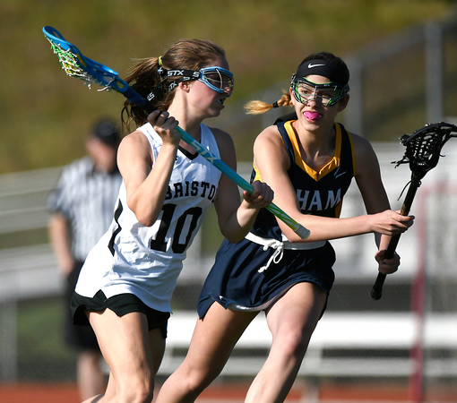 5/8/2018 Mike Orazzi | Staff Bristol Co-Op Lacrosse's Lily Hansen (10) and RHAM's Elisabeth Miano (2) during girls lacrosse at BEHS Tuesday.