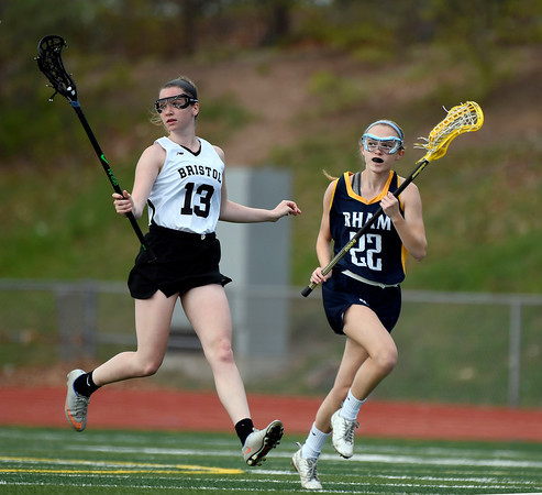 5/8/2018 Mike Orazzi | Staff RHAM's Morgan Czarnecki (22) and Bristol Co-Op Lacrosse's Jade Longo (13) during girls lacrosse at BEHS Tuesday.