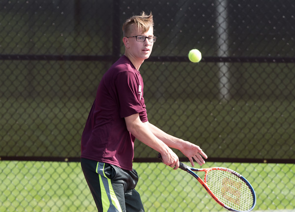 05/08/18 Wesley Bunnell | Staff Berlin boys tennis hosted New Britain on Tuesday afternoon at Berlin High School. New Britain's Nick Makuch in his singles match against Berlin's Ryan Jenkins.