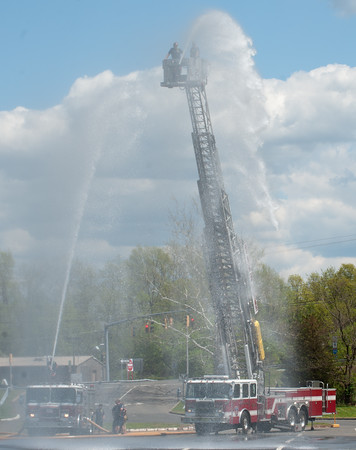 05/08/18 Wesley Bunnell | Staff Ladder #2 and Engine #2 of the New Britain Fire Department conducted training and testing on equipment on Tuesday afternoon at Willow Brook Park. Firefighters on top of Ladder #2 are John Golebiewski and Frank Medina.