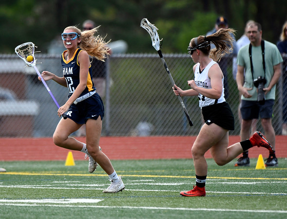 5/8/2018 Mike Orazzi | Staff Bristol Co-Op Lacrosse's Ashley Macdonald (12) and RHAM's Shannon Romeo (12) during girls lacrosse at BEHS Tuesday.