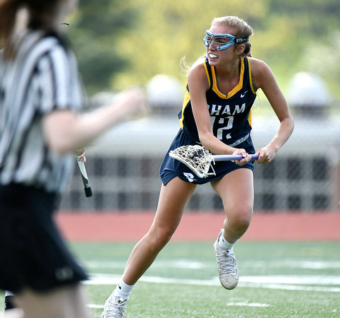 5/8/2018 Mike Orazzi | Staff RHAM's Shannon Romeo (12) during girls lacrosse at BEHS Tuesday.
