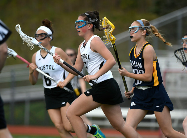 5/8/2018 Mike Orazzi | Staff Bristol Co-Op Lacrosse's Jenna Lowe (1) and RHAM's Morgan Czarnecki (22) during girls lacrosse at BEHS Tuesday.