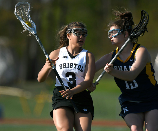 5/8/2018 Mike Orazzi | Staff Bristol Co-Op lacrosse's Aly Policarpio (3) and RHAM's Meghan Fraleigh (13) during girls lacrosse at BEHS Tuesday.