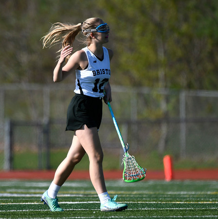 5/8/2018 Mike Orazzi | Staff Bristol Co-Op lacrosse's Corinna Marsh (12) during girls action with RHAM at BEHS Tuesday.