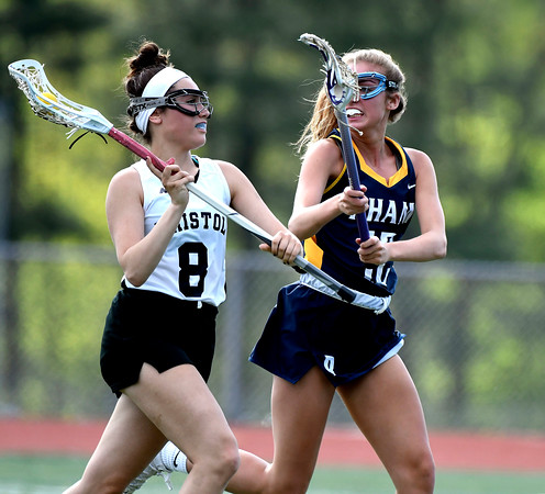 5/8/2018 Mike Orazzi | Staff Bristol Co-Op Lacrosse's Gabby Abramczyk (8) and RHAM's Shannon Romeo (12) during girls lacrosse at BEHS Tuesday.