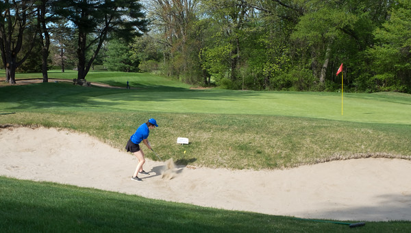 05/09/18 Wesley Bunnell | Staff Berlin girls golf vs New Britain on Wednesday afternoon at Timberlin Golf Course in Berlin. Berlin's Bridget McQuillan hits out of a sand bunker.