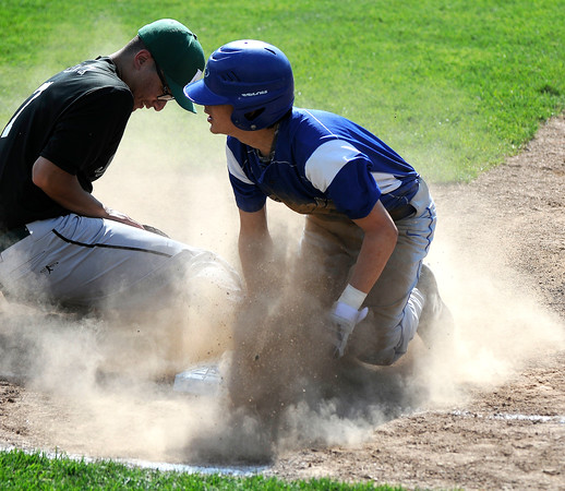 5/9/2018 Mike Orazzi | Staff Bristol Eastern's Carson Sassu (1) slides safely back into first base as Maloney's Nick Song­Carabetta (7) takes the throw at Muzzy Field Wednesday.