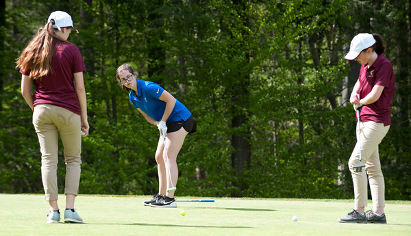 05/09/18 Wesley Bunnell | Staff Berlin girls golf vs New Britain on Wednesday afternoon at Timberlin Golf Course in Berlin. Berlin's Alena Kittleman putts as New Britain's Kiley Griffin and Katherine Keithline look on.