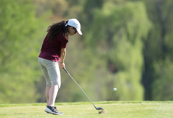 05/09/18 Wesley Bunnell | Staff Berlin girls golf vs New Britain on Wednesday afternoon at Timberlin Golf Course in Berlin. New Britain's Leah Gaffney hits a tee shot.