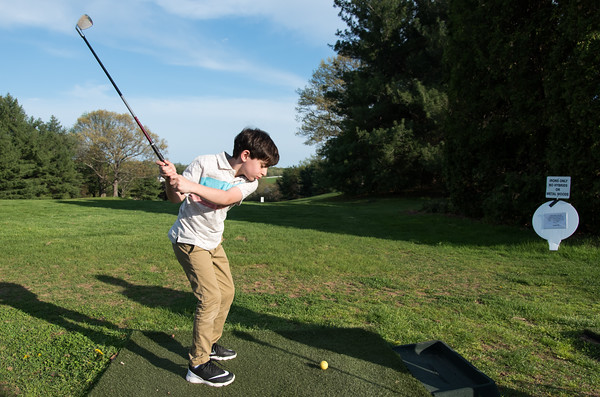 05/09/18 Wesley Bunnell | Staff 9 year old Raffi Blocher takes his final swing of his lesson with Timberlin Head Golf Professional Marc S. Bayram, PGA, on Wednesday afternoon.