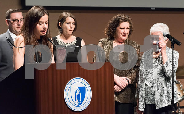 11/4/17 Wesley Bunnell | Staff The Immigrant Heritage Hall of Fame inducted 6 members on Saturday evening at Alumni Hall at CCSU. Members of inductee Franciszek Herzog listen as Agnes Romanowska makes the introduction.