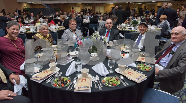 11/4/17 Wesley Bunnell | Staff The Immigrant Heritage Hall of Fame inducted 6 members on Saturday evening at Alumni Hall at CCSU. Guests sit at the table reserved for the family of Rabbi Henry Okolica.