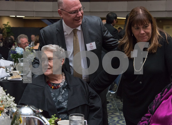 11/4/17 Wesley Bunnell | Staff The Immigrant Heritage Hall of Fame inducted 6 members on Saturday evening at Alumni Hall at CCSU. Inductee Bessy Reyna sits at her table as guests drop by.