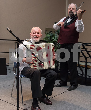 11/4/17 Wesley Bunnell | Staff The Immigrant Heritage Hall of Fame inducted 6 members on Saturday evening at Alumni Hall at CCSU. Musicians perform at guests enjoy their dinner.