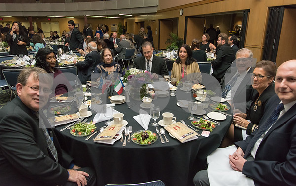 11/4/17 Wesley Bunnell | Staff The Immigrant Heritage Hall of Fame inducted 6 members on Saturday evening at Alumni Hall at CCSU. Guests sit at the table reserved for inductee The Honorable Mohammad Nawaz Wahla.