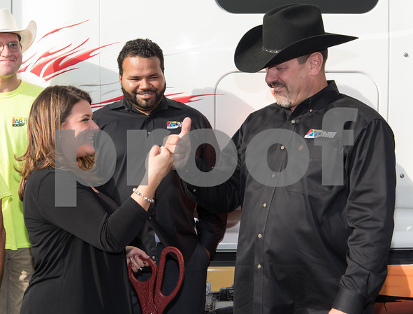 11/3/17 Wesley Bunnell | Staff AB CDL Driver Training School held a ribbon cutting on Friday afternoon celebrating their new location at 221 South St. Mayor Erin Stewart fist bumps owner Thomas Moysey after the ribbon cutting as New Britain Campus Director Edgardo Cruz looks on.