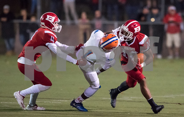 11/3/17 Wesley Bunnell | Staff Bloomfield vs Berlin football on Friday night at Sage Park. Andrew Brochu (4) and Larry St. Pierre Jr with the ball as he is face masked. A penalty would be called on the play.