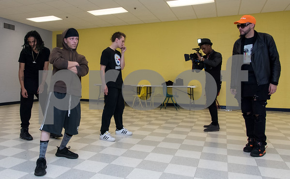 11/6/17 Wesley Bunnell | Staff Hoping to make it as the next big boy band members of We Are V1ral, WAVE, practice at The Boys & Girls Club on Monday evening. Members Lokz, L, Shoog and Dimas practice their moves while being filmed by DT of B&D Visual Entertainment while manager Stevey Newnez looks on.