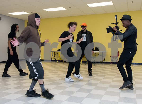 11/6/17 Wesley Bunnell | Staff Hoping to make it as the next big boy band members of We Are V1ral, WAVE, practice at The Boys & Girls Club on Monday evening. Members Lokz, L, Shoog and Dimas practice their moves while manager Stevey Newnez looks on and DT of B&D Visual Entertainment films.