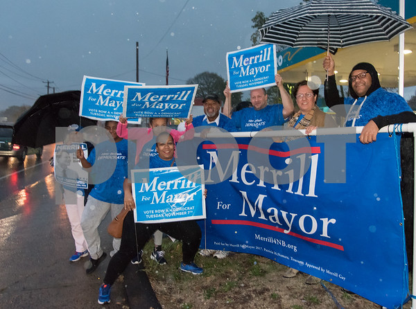 11/6/17 Wesley Bunnell | Staff Supporters of mayoral candidate Merrill Gay stand in the rain on the corner of West Main & Corbin Ave on Monday afternoon ahead of Tuesday's elections. Isabella Cancel, L, Adrianna Luciano, Mariah Santiago, Marsha Michaud, alderman candidate Brian Keith Albert, alderman candidate Francisco Santiago, Yvonne Muniz and Edgar Lopez.
