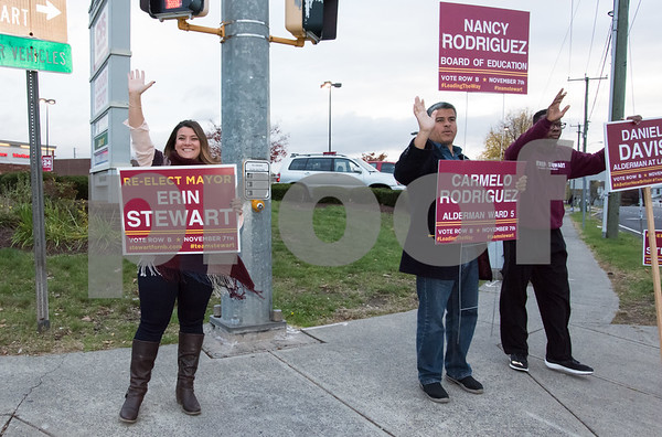 11/6/17 Wesley Bunnell | Staff Mayor Erin Stewart, Alderman Carmelo Rodriguez and Alderman Daniel Davis wave to motorists on the corner of West Main & Corbin Ave on Monday afternoon ahead of Tuesday's elections.
