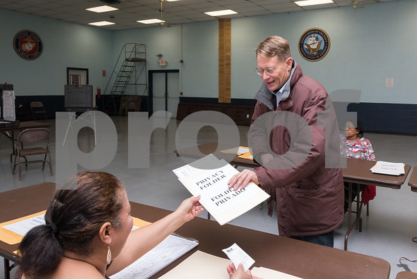 11/7/17 Wesley Bunnell | Staff Democratic candidate for Mayor Merrill Gay receives his voting ballot at the VFW on Tuesday morning.