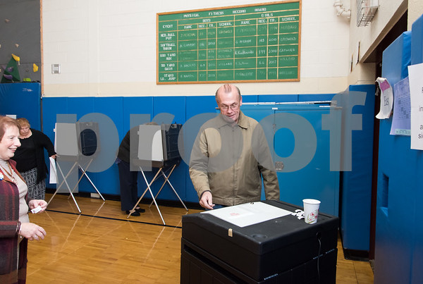 11/7/17 Wesley Bunnell | Staff The Griswold School polling location was busy throughout the day Tuesday. John McCloskey enters his completed ballot into the machine.