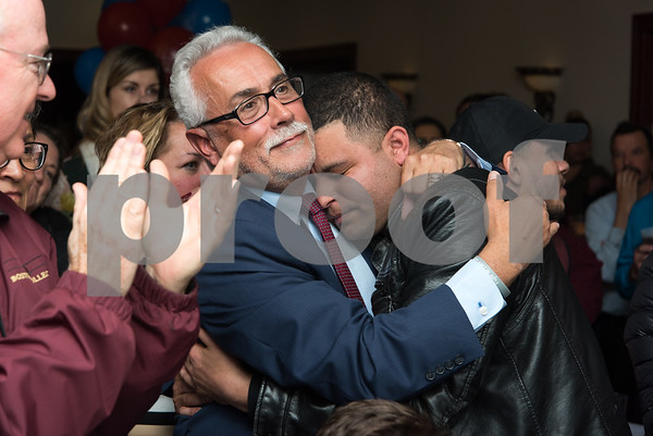 11/7/17 Wesley Bunnell | Staff Team Stewart at their election night headquarters at The Back Nine Tavern at Stanley Golf Course. Alderman Daniel Salerno hugs Alderman Kristian Rosado after being overcome with emotion after winning re-election.